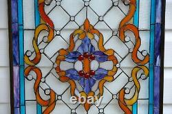 Handcrafted Jeweled stained glass window panel. 20.25W x 34H